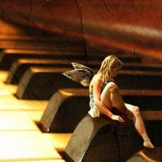 fairy sitting on piano