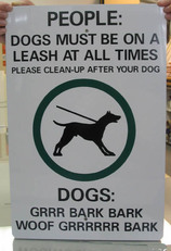 people dogs must be a on leash at all times please clean up after your dog sign